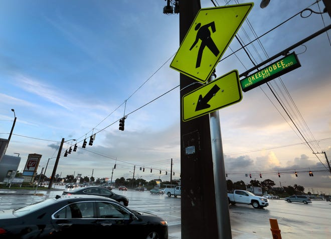 Cars on Military Trail at the light, as traffic on Okeechobee Boulevard heads east. Okeechobee and Military is among the most dangerous intersections in Palm Beach County.