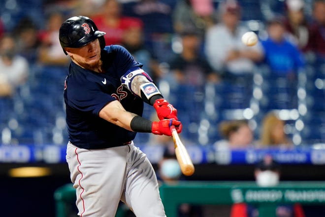 Boston's Christian Vazquez hits a three-run double in the ninth inning of Friday night's game against the Philadelphia Phillies, an 11-3 victory for the Red Sox.