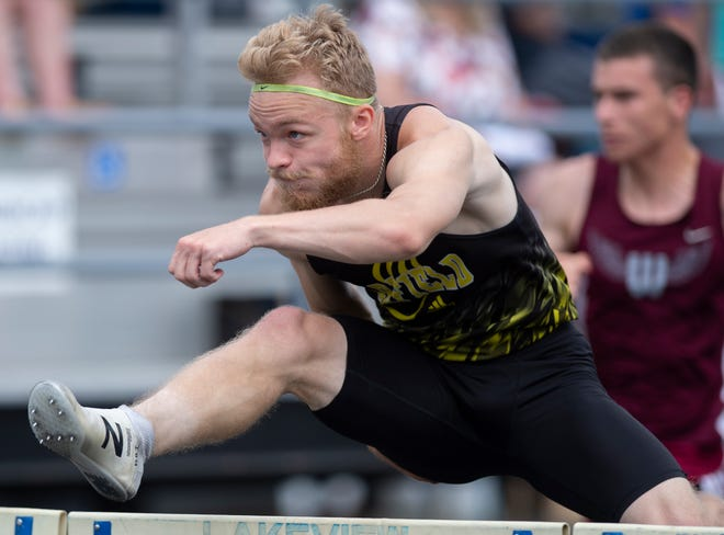 Ryan Stoller of Garfield competes in the 110-meter hurdles at the Division II district track & field championships Saturday at Lakeview High School.