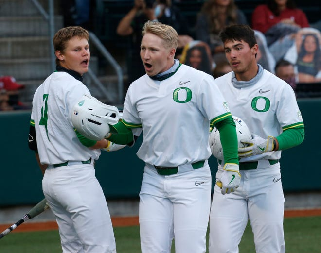 Oregon's Gabe Matthews, center, homered in Thursday's 11-5 win over California, and Josh Kasevich, left, had three hits and three RBIs.