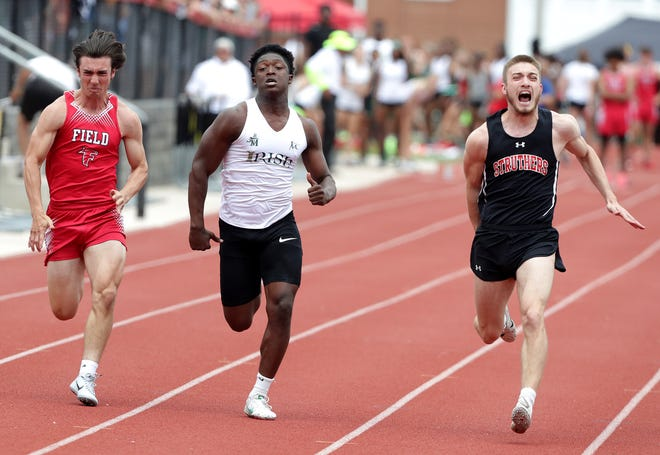 Darrian Lewis of St. Vincent-St. Mary, center, competes in the 100-meter dash against Field's Nick Dokosky, left, and Aiden Hall of Struthers, right, at the Division II District Track and Field Meet at Salem High School.