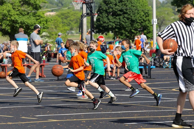 The Flodin Boys & Girls Club moved its youth basketball leagues for grades 1-6 outdoors to the parking lot at neighboring Elliot Golf Course this year in order to have a season despite COVID restrictions. Saturday's double-header games were the final games of the season.