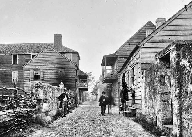 A photograph from the Library of Congress shows a street in St. Augustine in the 1860s.