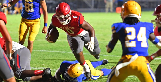 Manatee High's Kyree Jones scores a touchdown against Charlotte High Friday night during the Spring Classic hosted by Venice High School at Powell-Davis Stadium.