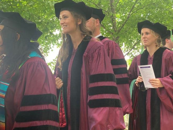 Maria Mosley and other SIU School of Medicine students process onto Ken Leonard Field at Cyclone Stadium for Saturday's graduation. Mosley will train in emergency medicine at New York-Presbyterian Columbia/Cornell.
