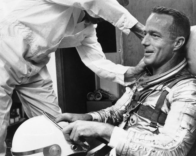 Astronaut Scott Carpenter gets a final going over from a suit technician as he prepares for an orbital flight at Cape Canaveral, Florida, on May 24, 1962. Carpenter became the second American to orbit the Earth as he flew aboard Aurora 7