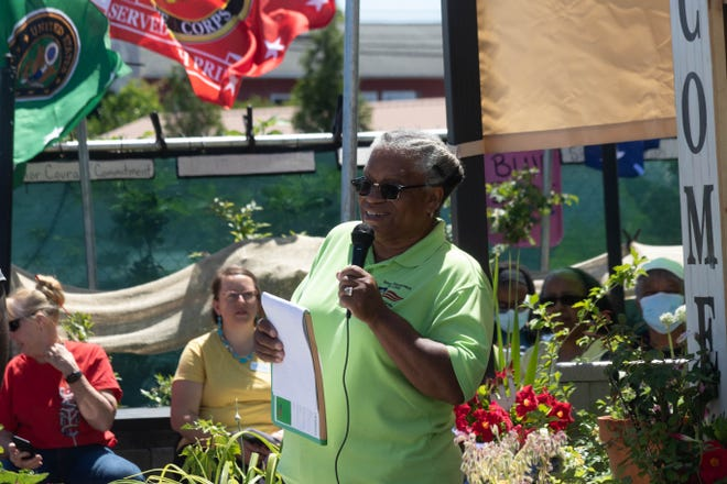 Garden founder Lovay Wallace-Singleton opens the ribbon-cutting ceremony.