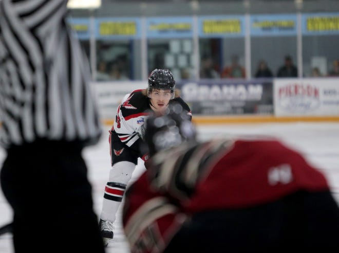 Aberdeen Wings defenseman Nico DeVita waits outside of the circle during a faceoff with the Minot Minotauros in the first period of Game 1 in the Central Division Semifinals. The Wings have advanced to the Robertson Cup Championship in Blaine, Minn.