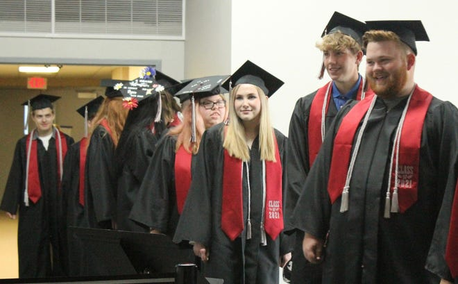 Aberdeen Christian High School seniors line up for the procession at Saturday's graduation. From right are Ezekiel Becker, Jett Becker, Amy Haase, and Faith Harms.