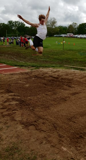 Hayden senior Jack Konrade competes in the triple jump at the Class 4A track regional Friday at Tonganoxie. Konrade won the long jump and also qualified for state in the triple jump and as part of the Wildcats' 400 relay team.