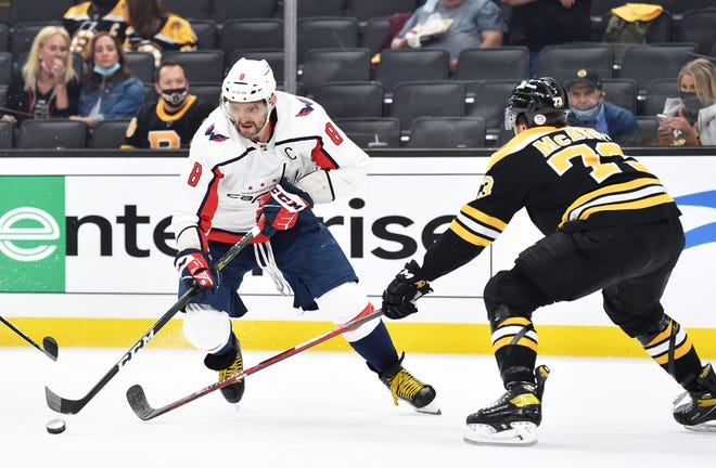 Bruins defenseman Charlie McAvoy, right, keeps Capitals left wing Alex Ovechkin in check during Game 3 on Friday night at TD Garden.