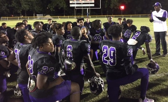 GHS coach Dock Pollard talks to his team after Friday's spring game at Citizens Field.