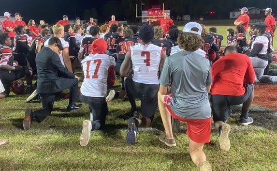 Santa Fe huddles up after its win over Eastside.