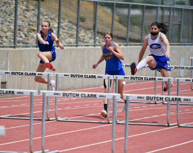 Swallows Charter Academy freshman Kaitlyn Pearson, left, Custer County senior Kaydin Moore, middle, and Pueblo Central sophomore Seven Wilton, right, compete in the girls 100-meter hurdles Friday, May 21, 2021 at Dutch Clark Stadium.