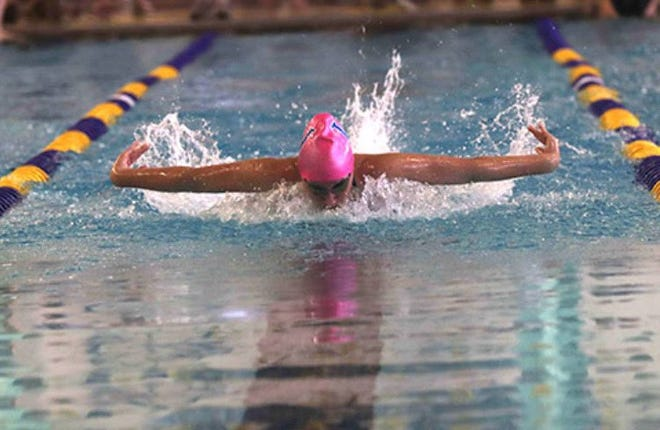 Jensen Lynnes competing in a swimming event