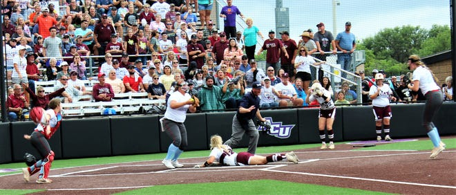The home plate ump calls out Eula baserunner Brayli Collins (12) after she was tagged by Borden County pitcher Rexie Sanders while trying to score on a passed ball. Players on each team react to the final out of the Class 1A game, won by Borden County to send the Lady Coyotes to the state tournament.