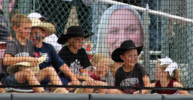 Young Eula fans came in cowboy hats to cheer the Lady Pirates, especially No. 9, Avery Meers, the lead-off batter and catcher. That's her face behind her fans. The Lady Pirates lost 6-3 to Borden County in a one-game playoff to determine a berth at the Class 1A state softball tournament.