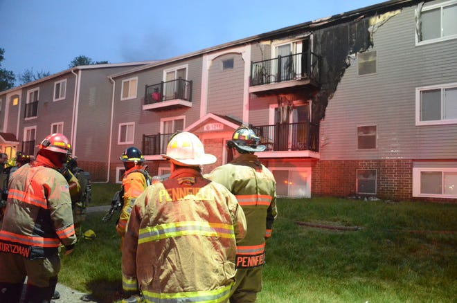 A fire Friday forced evacuation of residents in 11 units at Bailey Park Apartments in Pennfield Township.  (Trace Christenson/The Enquirer)