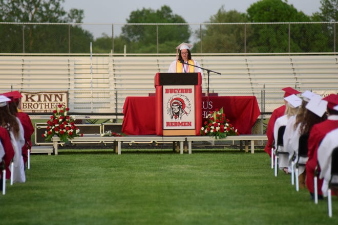 Senior class president Morgan Young speaks to her classmates about resilience Friday during the Bucyrus Class of 2021 commencement.