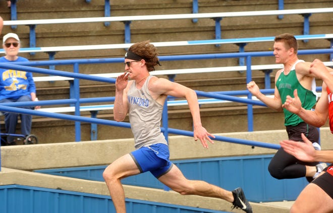Wynford's Kolten Bils races in the 100 dash at the D-II district meet.