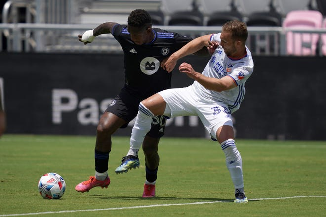 May 22, 2021; Fort Lauderdale, FL, Fort Lauderdale, FL, USA; FC Cincinnati midfielder Caleb Stanko (33) and CF Montreal forward Romell Quioto (30) battle for the ball during the second half at DRV PNK Stadium.