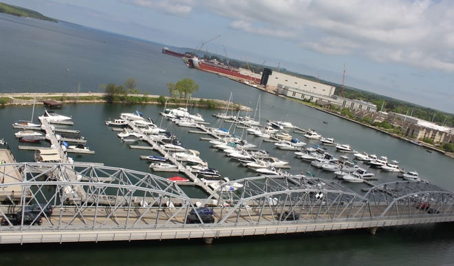 Looking toward the historic Michigan Street Bridge, yacht slips, Fincantieri Bay Shipbuilding's shipyard and the bay of Green Bay from the observation deck atop the 115-foor-tall Jim Kress Maritime Lighthouse Tower, which opened to the public Saturday at the Door County Maritime Museum in Sturgeon Bay.
