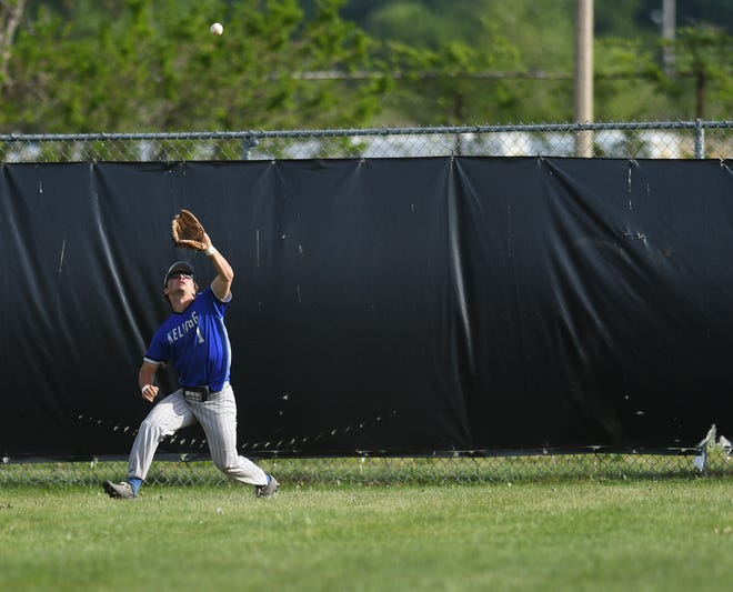 Kellogg Community College outfielder Ryan Reincke snags a pop fly Friday, May 21, 2021, during game 2 of best-of-three at the NJCAA Region XII baseball championship at Rudolph and Dorothy Wilson Park in Lansing.  KCC won 4-3.
