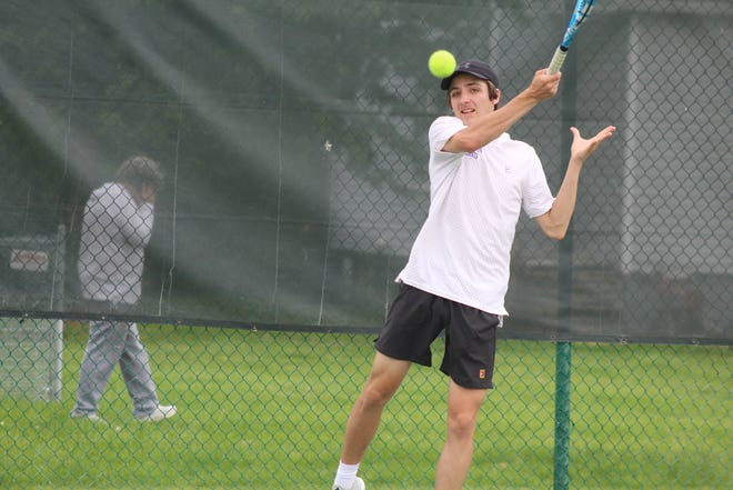 Lexington's Ross Drlik hits a shot during the Division II Port Clinton District Tennis Tournament on Saturday at Port Clinton High School. Drlik and teammate Ryan Mecurio won the district title in the doubles bracket.