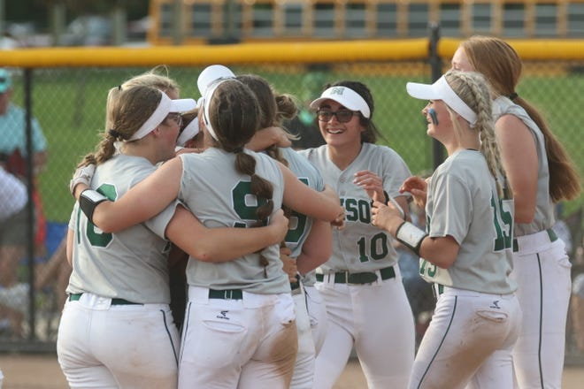 The Madison softball team celebrates a Division II district championship during the 2021 season. In 10 weeks, the high school football season kicks off.