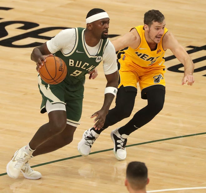 Bucks center Bobby Portis drives on Heat guard Goran Dragic during Game 1 of their playoff series last Saturday. Portis has played in eight playoff games since 2017, including the last two games with the Bucks.