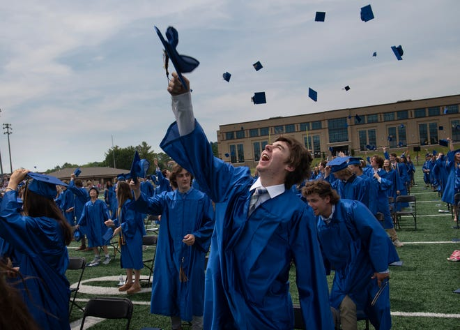 Graduate Ty Bragg tosses his cap following the Brentwood High School 39th commencement ceremony at James C. Parker Stadium Saturday, May 22, 2021 in Brentwood, Tenn.