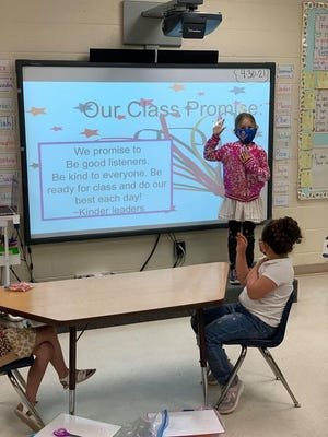 Aimee Parra's kindergarten class starts off with a class promise at Mesilla Elementary.