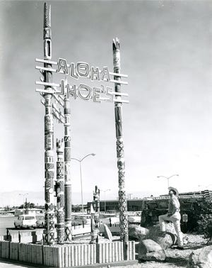Roadside signage of Aloha Jhoe's at 950 S. Palm Canyon Drive.