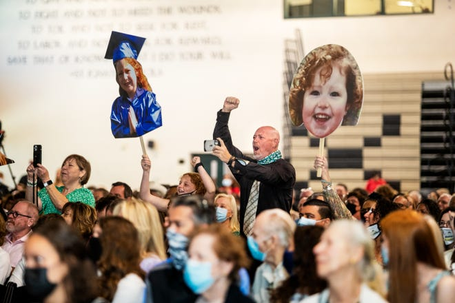 Family members cheer during Xavier College Prep's commencement in Palm Desert, Calif., on May 22, 2021.