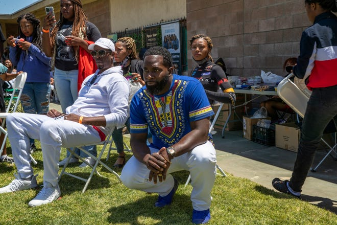 Jarvis Williams, center, watches as young men and women from the Building Resilience in African American Families Program perform during Unity Day in Palm Springs on Saturday.