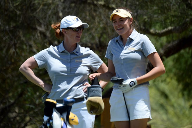 Kent State coach Lisa Strom, left, talks with player Caley McGinty during the NCAA women's golf championship at Grayhawk Golf Club in Scottsdale, Arizona, in May. Strom announced Friday she is returning to Ohio State, her alma mater, after two seasons with the Golden Flashes. (Joe Camporeale, USA TODAY Sports)