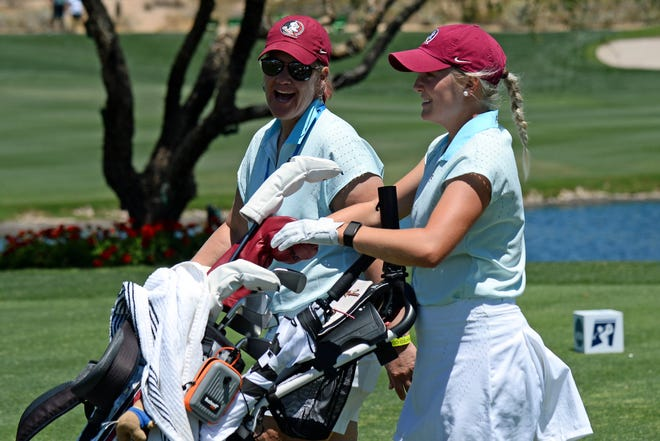 May 21, 2021; Scottsdale, Arizona, USA; Florida State Seminoles golfer Beatrice Wallin (right) walks with her coach Amy Bond on at the tenth fairway during the NCAA Women's Golf Championship at Grayhawk Golf Club. Mandatory Credit: Joe Camporeale-USA TODAY Sports