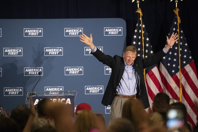 """Rep. Paul Gosar, R-Ariz., takes the stage to help out Reps. Matt Gaetz, R-Fla., and Marjorie Taylor Greene, R-Ga., at the """"America First"""" fundraiser event in Mesa, Ariz. on May 22, 2021. They arrive at a time when Gaetz is battling possible criminal charges and Greene has been stripped of her committees by Democrats. But to conservatives, they are some of the most prominent fighters in the post-Trump era."""