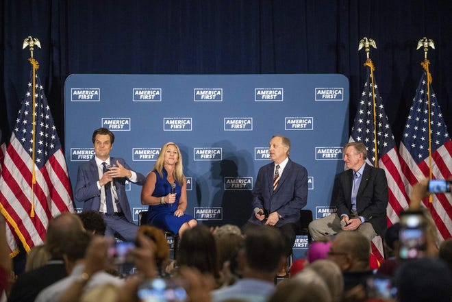 """From left to right: Reps. Matt Gaetz, Marjorie Taylor Greene, Andy Biggs and Paul Gosar take the stage at the """"America First"""" fundraising event in Mesa, Ariz. on May 22, 2021."""