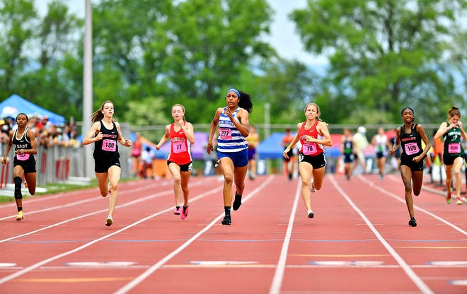 Spring Grove's Laila Campbell, center, wins the 3-A girls' 400-meter dash event at 56.43 during PIAA District III Track & Field Championships in Seth Grove Stadium at Shippensburg University in Shippensburg, Saturday, May 22, 2021. Dawn J. Sagert photo