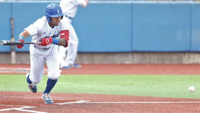 Lubbock Christian University leadoff batter Eduardo Acosta lays down a bunt during Saturday's championship game of the Lone Star Conference tournament in San Angelo. Angelo State beat LCU 10-3.
