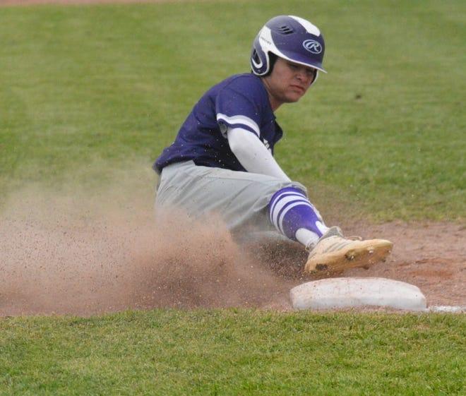 A Mason High School baseball player slides into third base during a District 29-2A baseball game in San Saba during the 2021 season.
