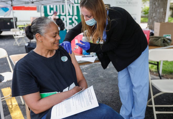 Renne High is vaccinated during a Mask Off Outreach event at Robberson Elementary School on May 22, 2021. Missouri's health department is encouraging communities with low vaccination rates, including southwest Missouri and Greene County, to protect themselves against virus variants spreading throughout the state.