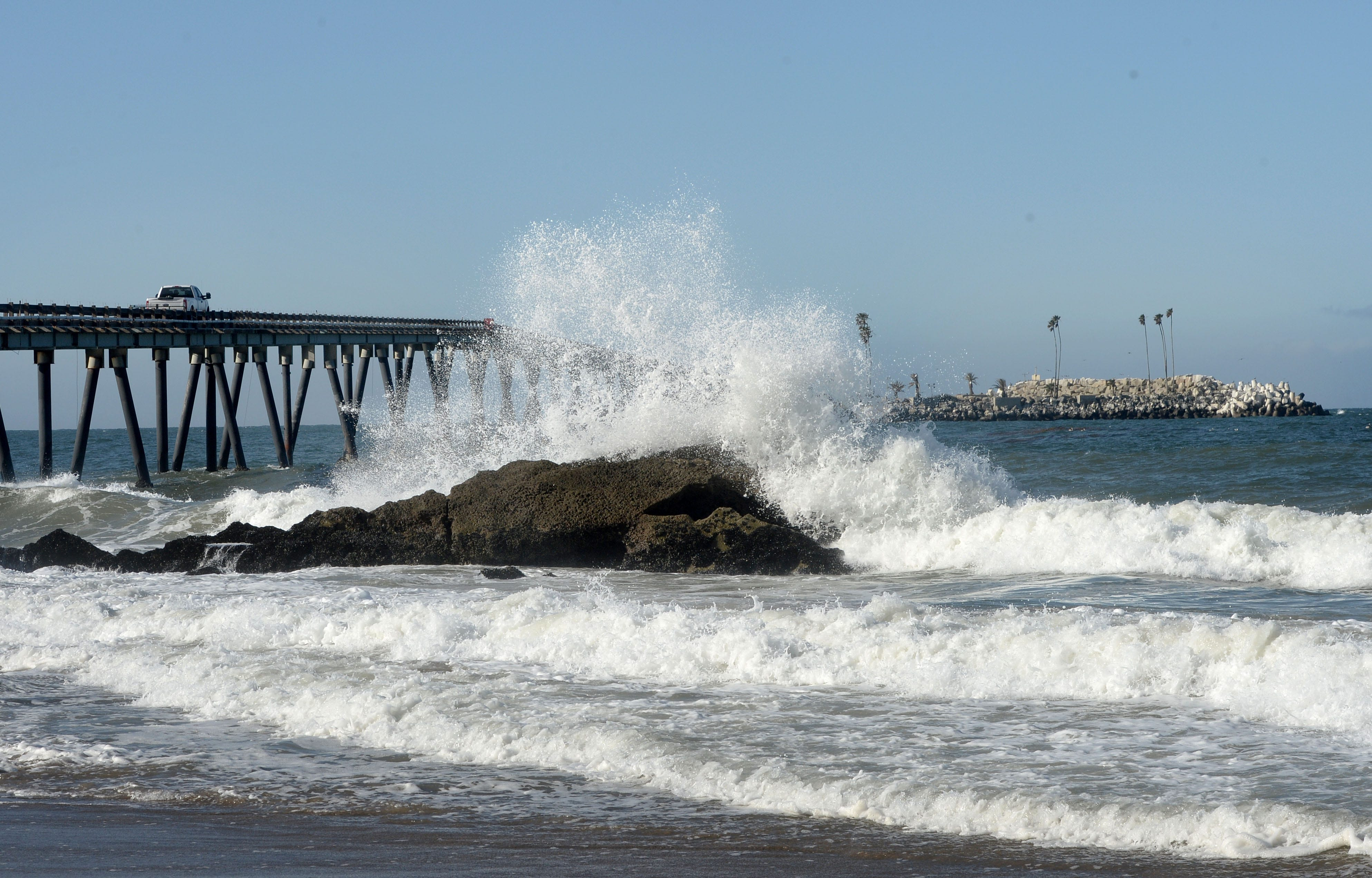 A wave crashes near Rincon Island just off the coast from Mussel Shoals. California taxpayers were left holding the bag for environmental cleanup on the former oil island.