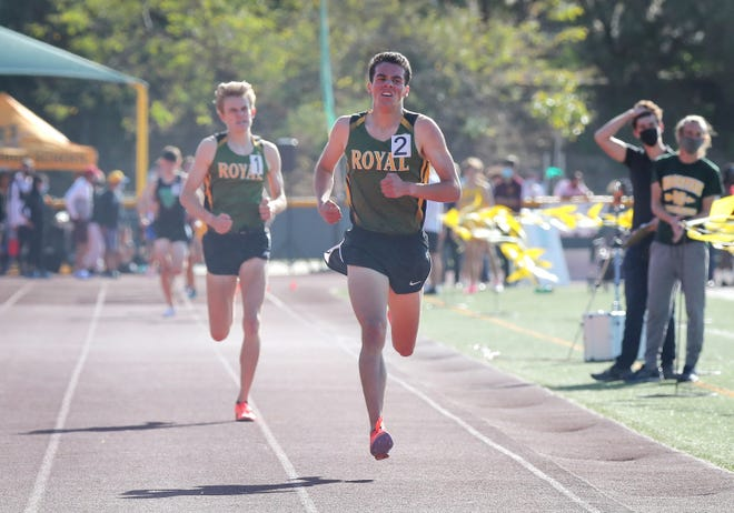 Royal High's Matthew Russell heads for the finish line ahead of teammate Angus Fitzgerald during the boys 1,600 final at the Ventura County Track and Field Championships on Friday at Moorpark High.