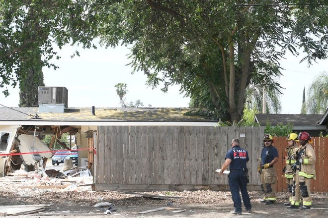 Visalia police are investigating what led to a major injury wreck that left a hole in a home and an orange truck overturned.