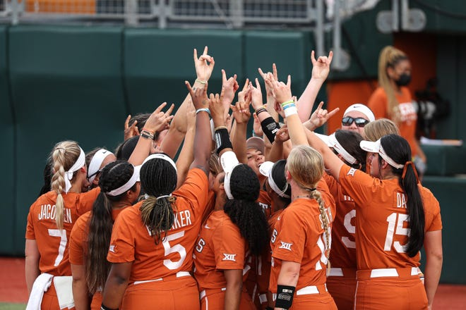 Texas' softball players huddle up to celebrate their 6-0 victory over Texas State on Saturday in the NCAA Austin Regional.