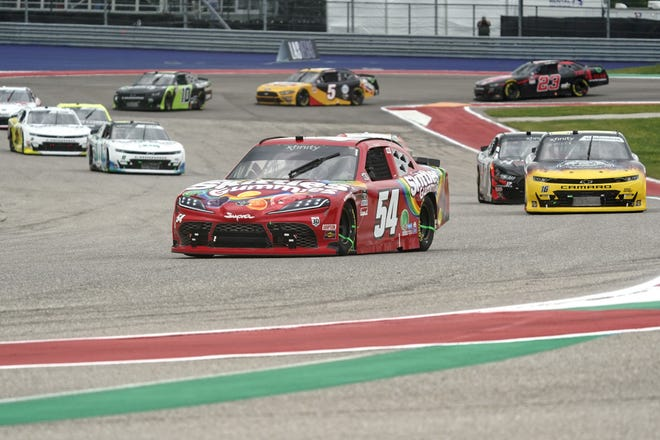 Kyle Busch leads the field into Turn 13 on his way to victory in the NASCAR Xfinity Series race Saturday at Circuit of the Americas.