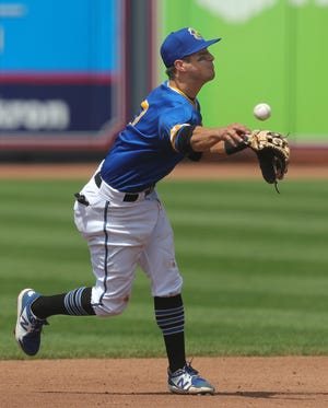 RubberDucks shortstop Tyler Freeman fires a throw to first during a recent game at Canal Park. Freeman and his Ducks teammates remain hopeful that there will be a postseason in the minor leagues this year. [Jeff Lange/Beacon Journal]