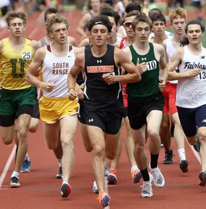 Marlington's Noah Graham, center, competes at the Eastern Buckeye Conference track & field championships.